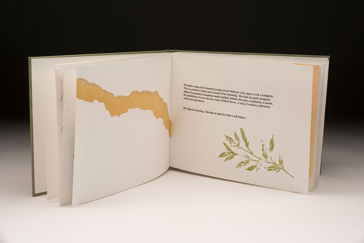 Inner pages of book displaying plants