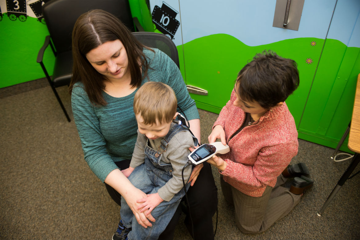 Audiologist working with a child