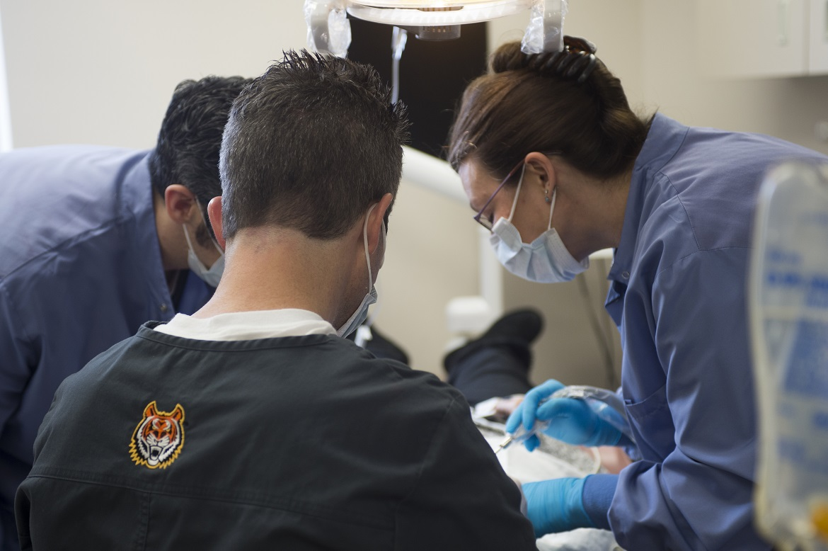 Dental Residents treating a patient.