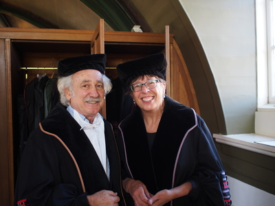 Two academics in robes and caps