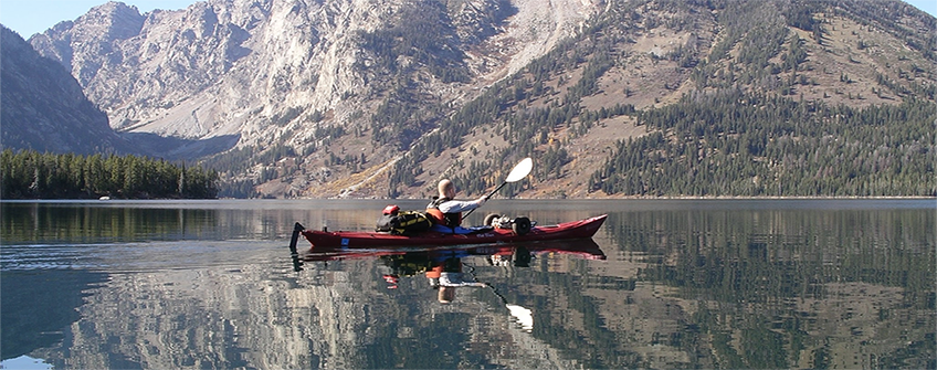 Students canoeing on a lake in the mountains