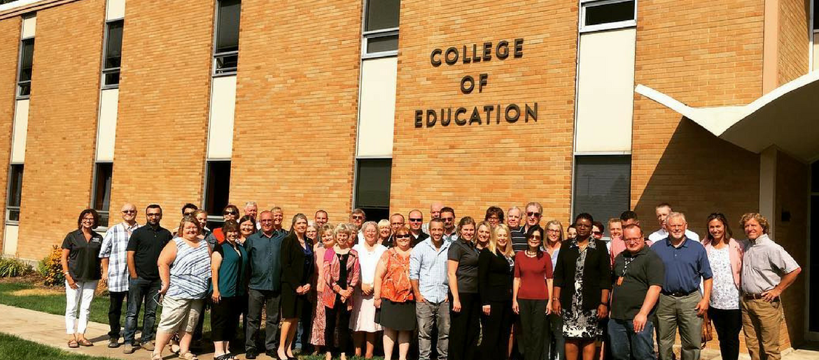 COE faculty and staff standing in front of the main COE building on campus