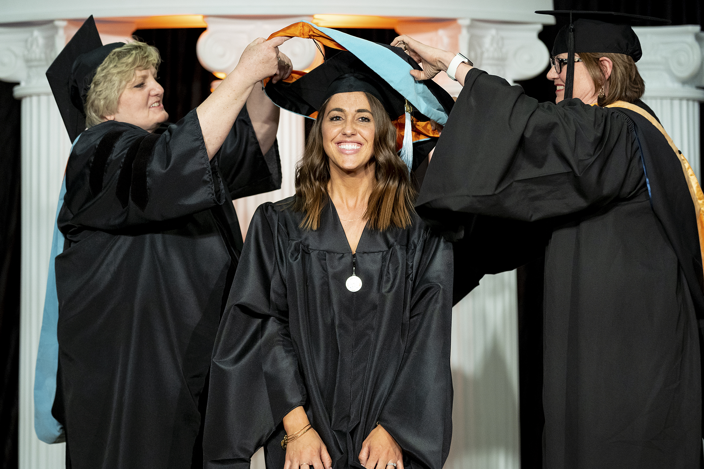 woman being hooded at hooding ceremony