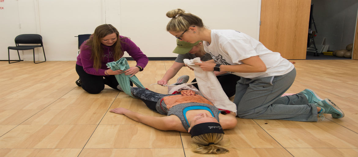 Students performing first aid