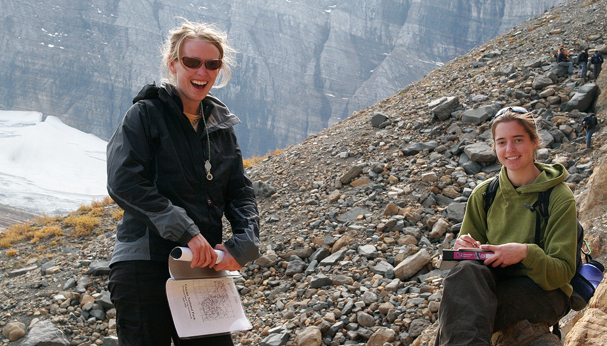Students in the mountians doing field work.
