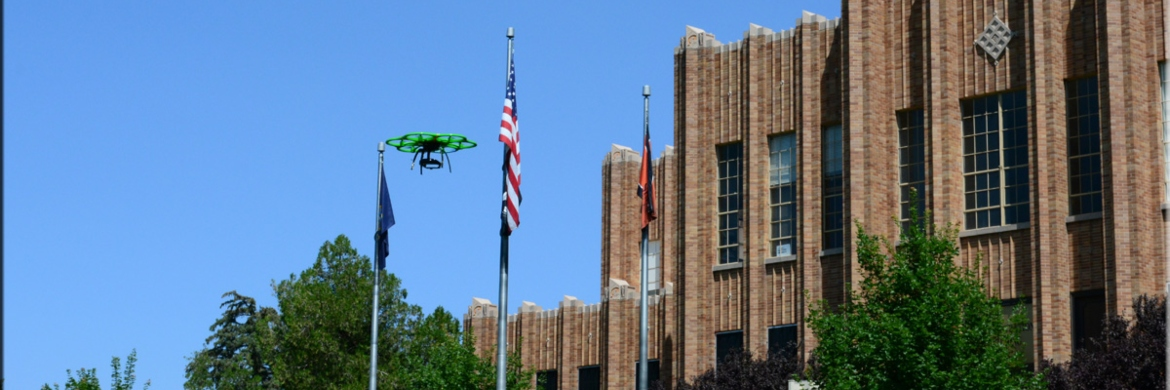 Drone flying in front of the ISU administration building