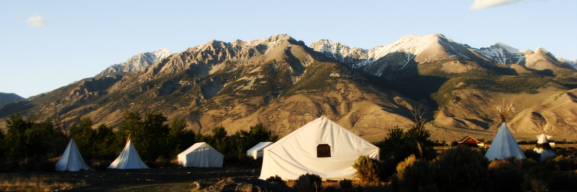tents in front of mountains at field camp