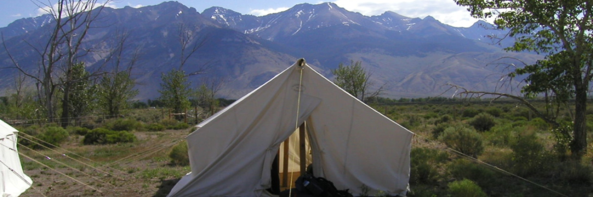 Tent in front of mountain range