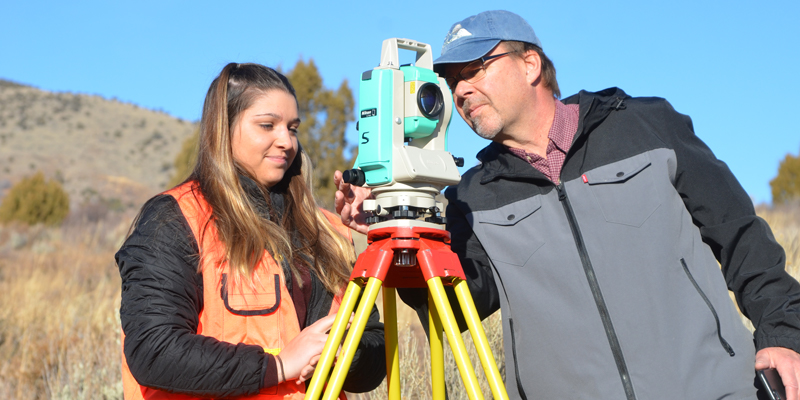 Robert Liimakka working with a Surveying and Geomatics Engineering Technology  student