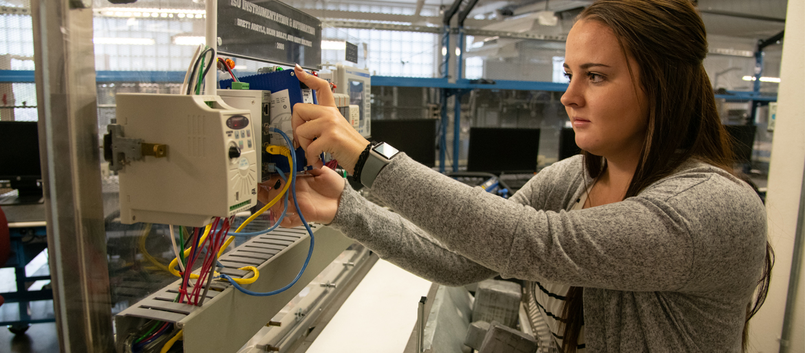 Energy Systems Industrial Cybersecurity student working in a lab