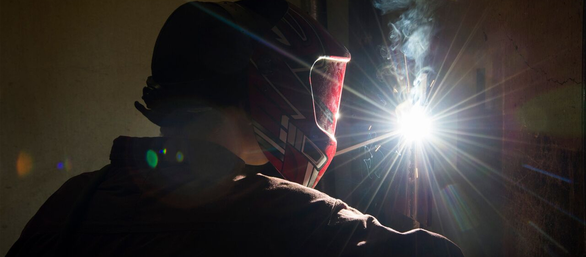 Welding student practicing in lab