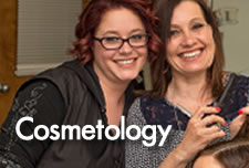 Cosmetology Student and Instructor working in Cosmetology Center