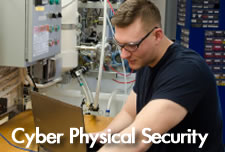 Cyber Physical Security Student working on servers