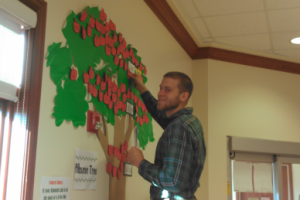 Nutrition student pins up albumin tree, used to help teach long term care residents about their risk for malnutrition