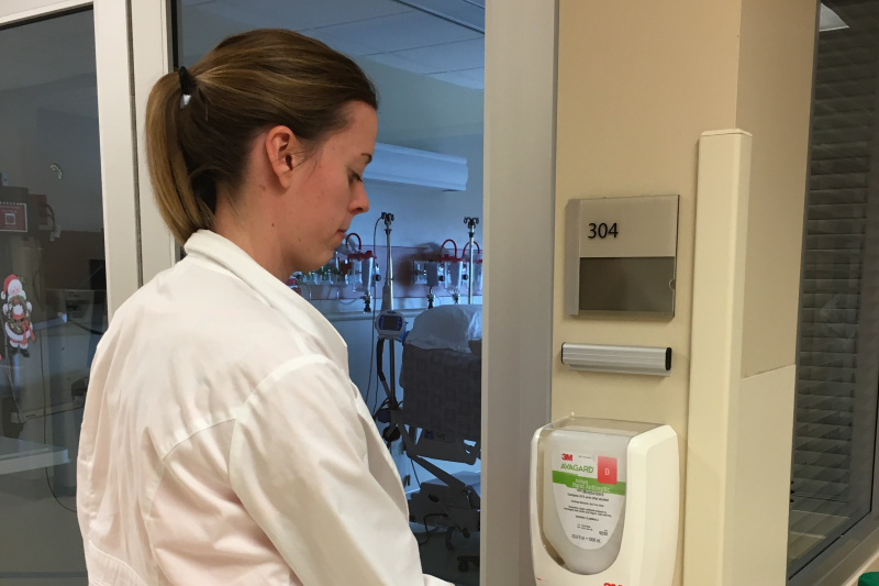 Dietetic intern washes hands after entering hospital room and before interacting with patient
