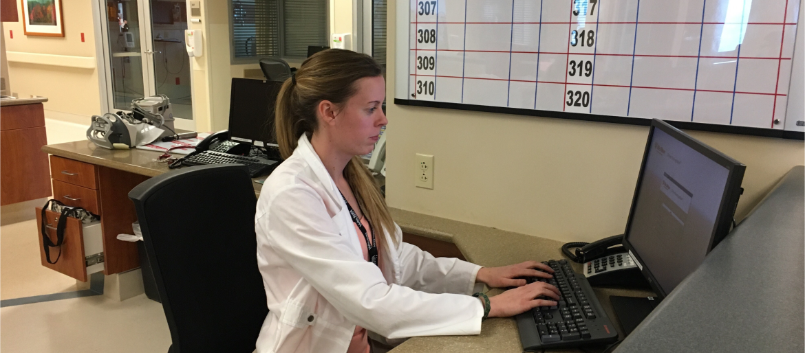 Dietetic intern in hospital charting in electronic health record