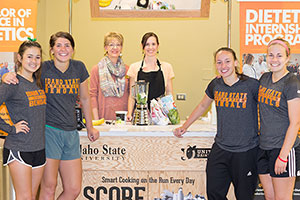 Dietetic students providing food demo in the community