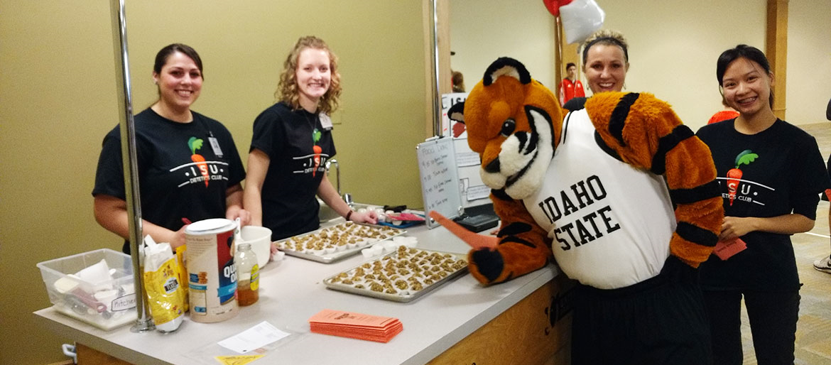 Dietetic students giving community cooking demonstration, Benny Bengal stopped by to say hi