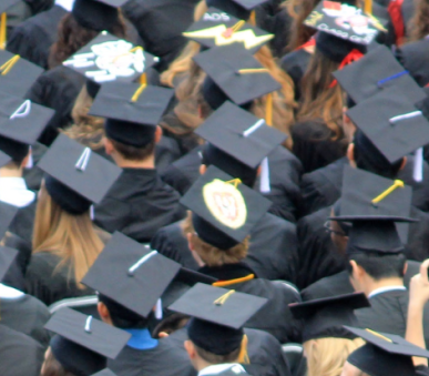 Aerial view of graduation ceremony, showing graduation caps of group of students