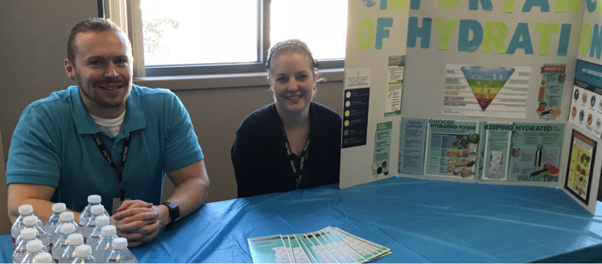 Community nutrition students educate seniors at community health fair about the importance of staying hydrated