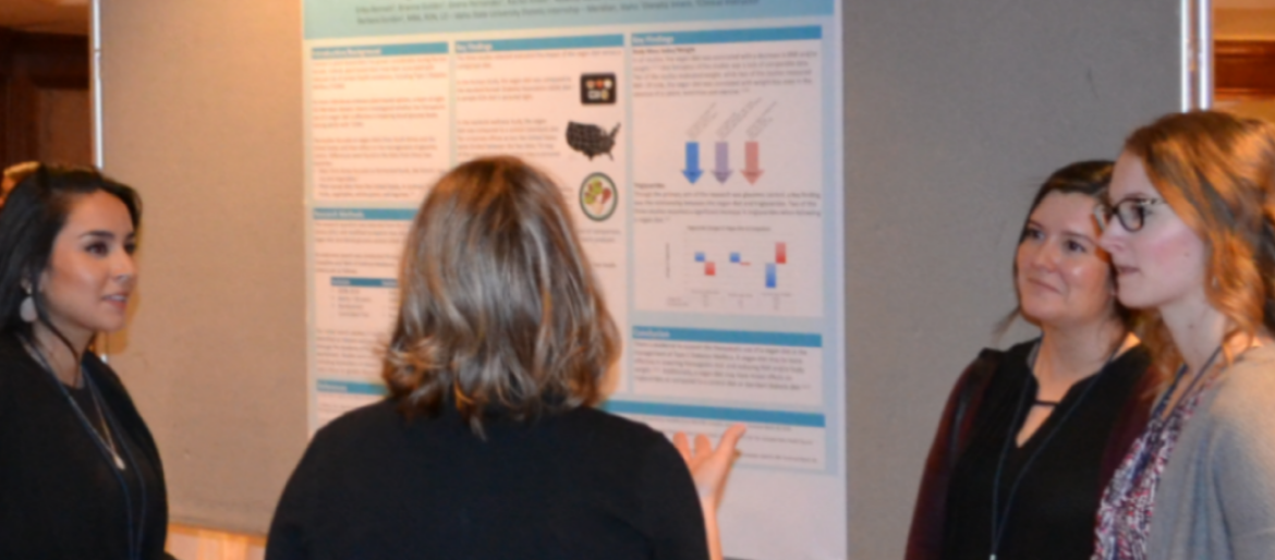 Dietetic interns present their research findings during poster session at state dietetics meeting