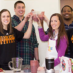 Sports dietitian and student athletes toasting to healthy eating