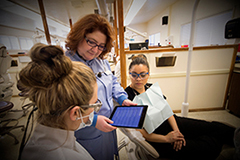 Male and female examine an X-Ray in the Physician Assistant studies program