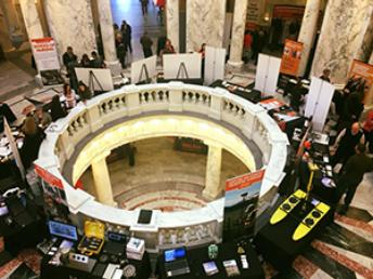 Idaho capitol building rotunda with ISU information booths during ISU Day at the Capitol 2018