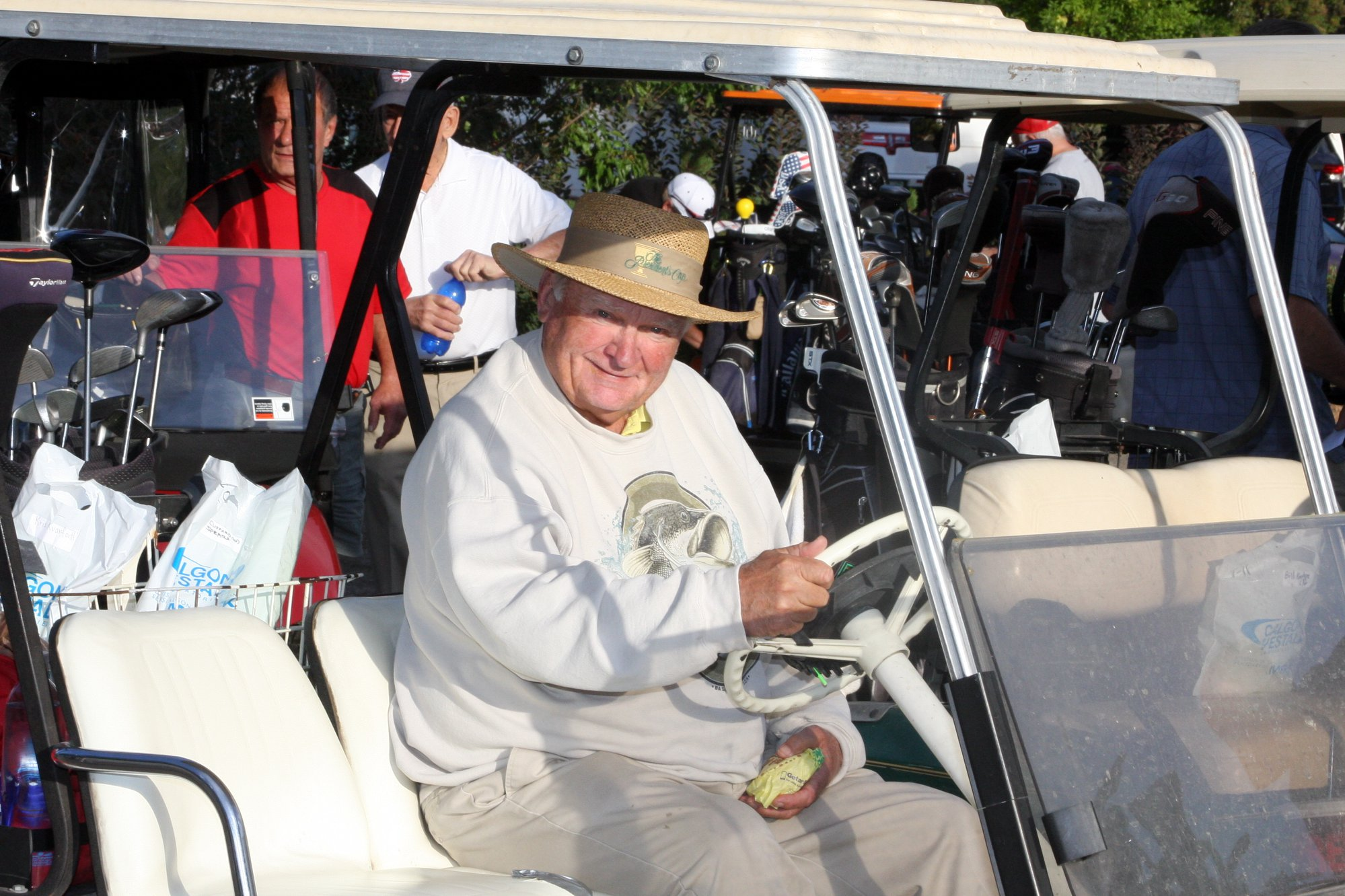 Older man in a golf cart