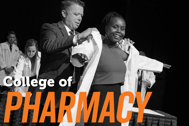 College of Pharmacy image with African American student receiving her white coat