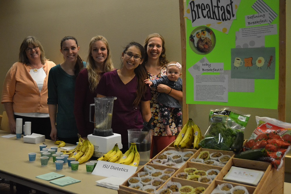 Dietetics Program Director with Students infront of booth.