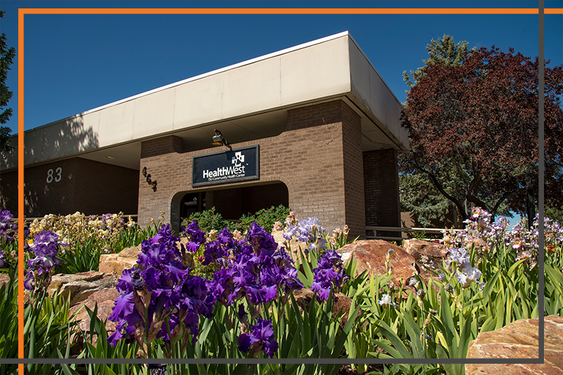 Brick Family Medicine building with purple flower and Health West ISU sign