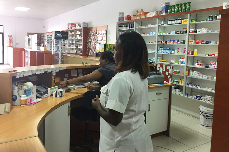 Two women work behind the counter at a pharmacy in Namibia, where Dr. David Hachey recently completed a sabbatical