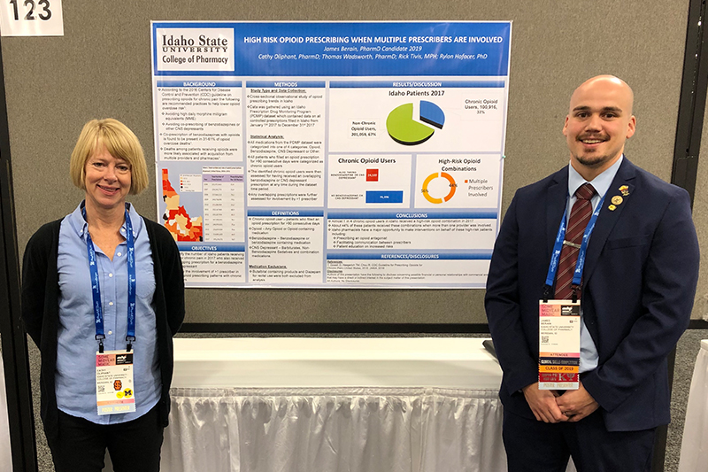 Professor Cathy Oliphant and Student Pharmacist James Berain present their research findings on opioid prescribing in Idaho at the American Society of Health System Pharmacists Midyear convention in Anaheim, CA