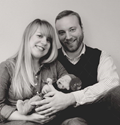 a picture of Jason Clark with his wife and child.