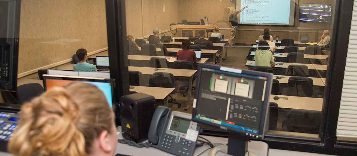 ETS worker monitoring a class during a lecture