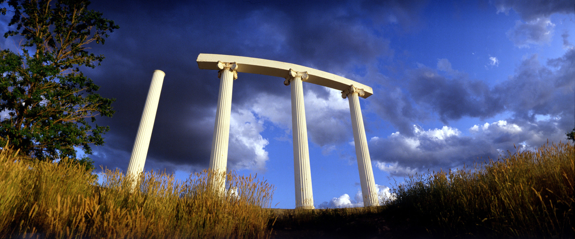 Columns on Red Hill with blue sky and clouds