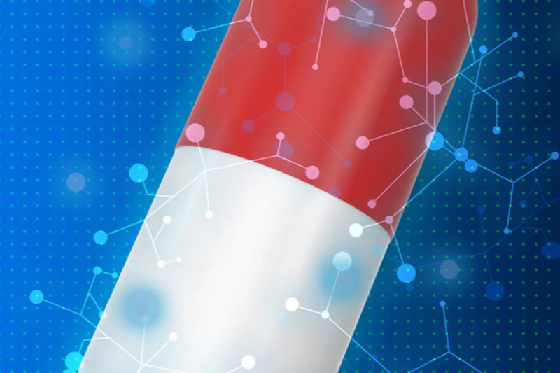 Picture of red and white pillow bottle with molecular images floating around it, on blue background