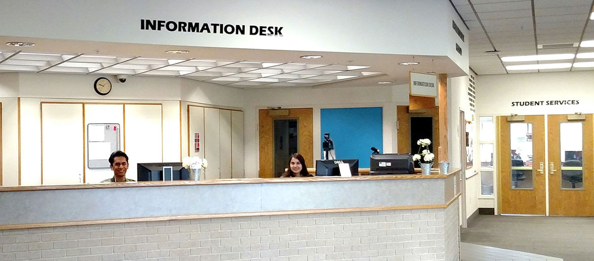 Students working at the information desk