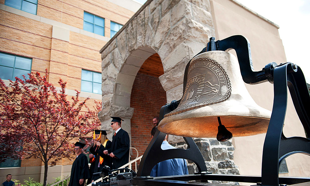 Graduation bell at Swanson arch