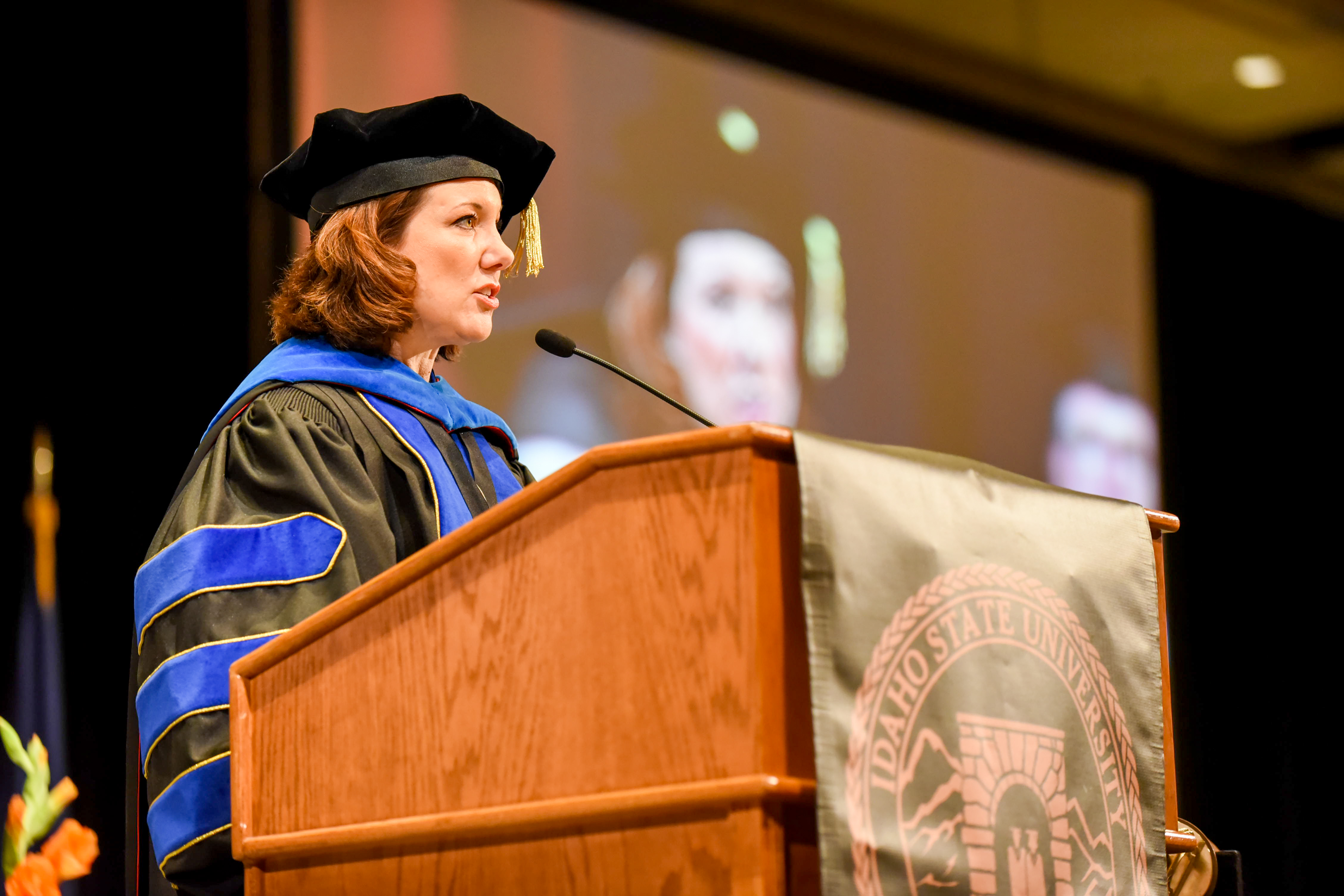 Dr. Laura Woodworth-Ney speaking at commencement