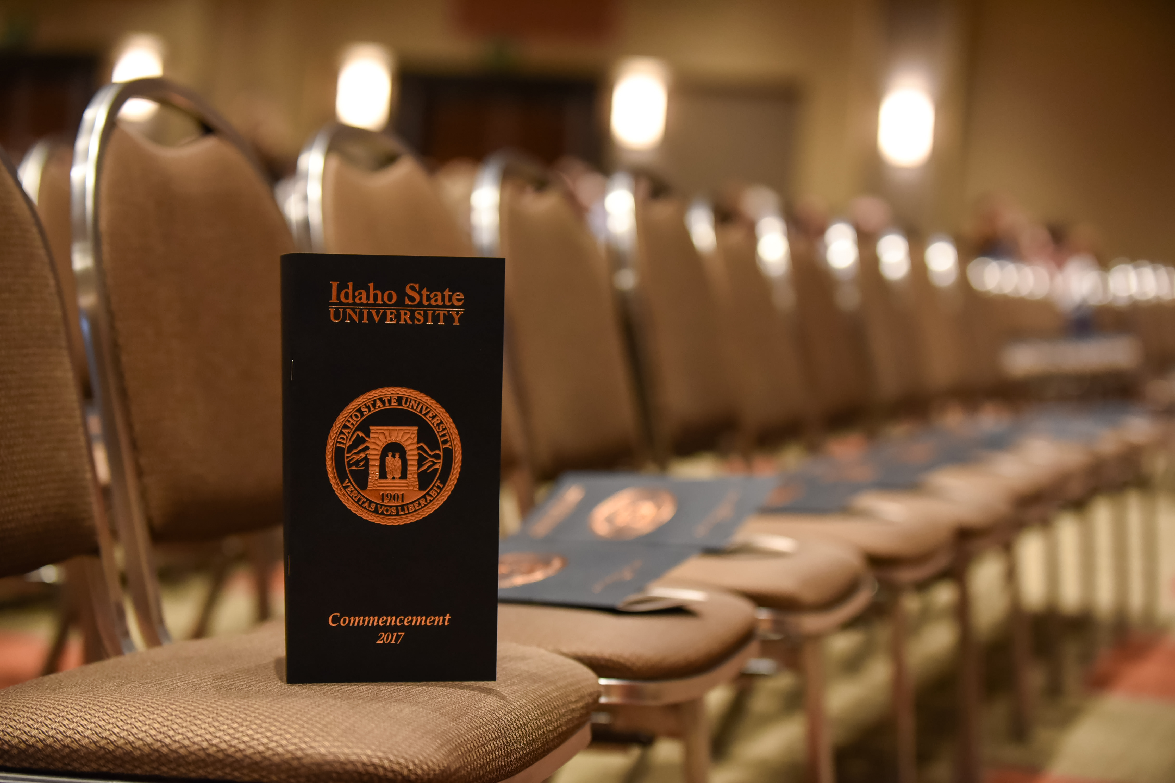 Commencement programs on chairs before the ceremony