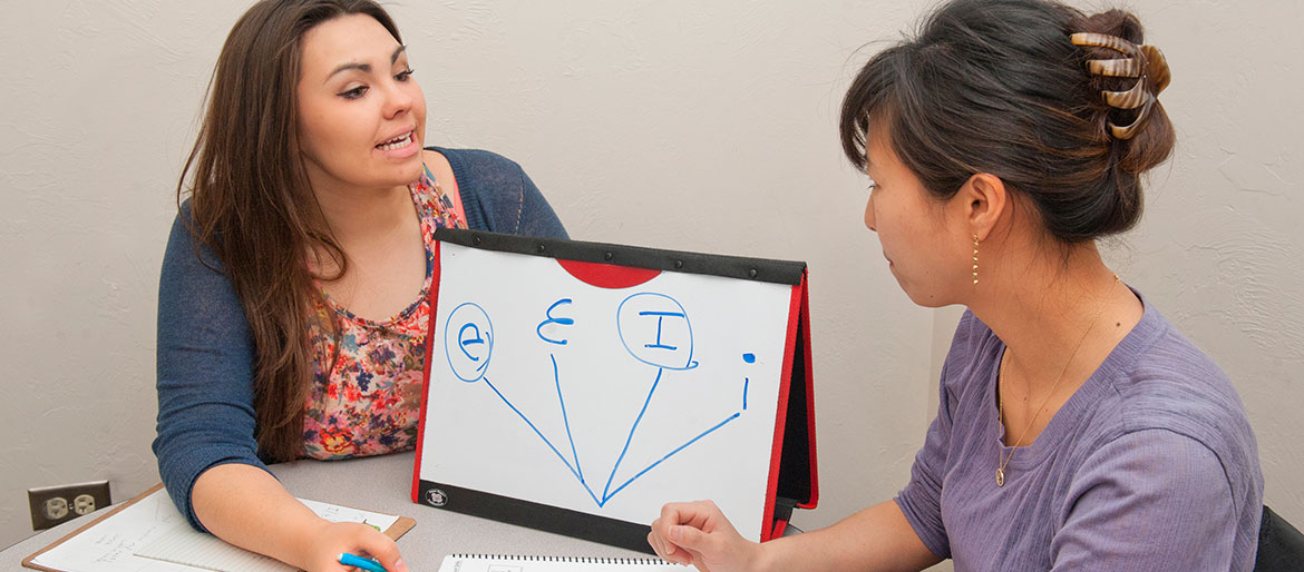 Speech pathology students discussing vowels