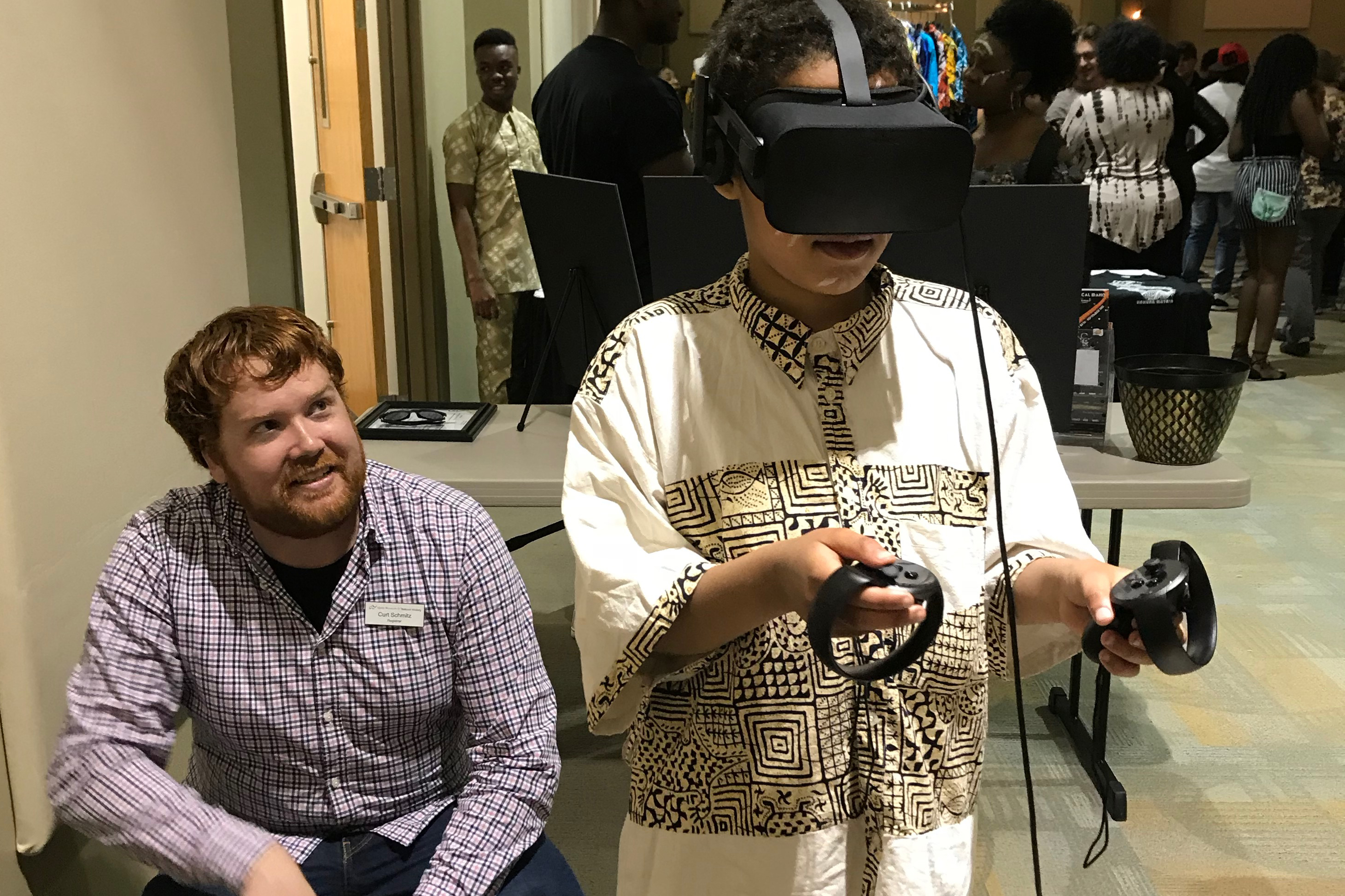 A young man testing virtual reality.