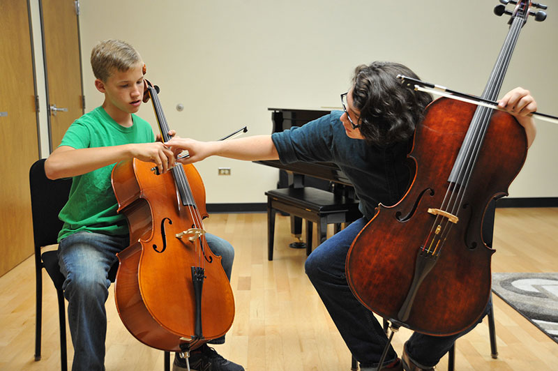 Cello Student taking lesson as part of the Preparatory String Program