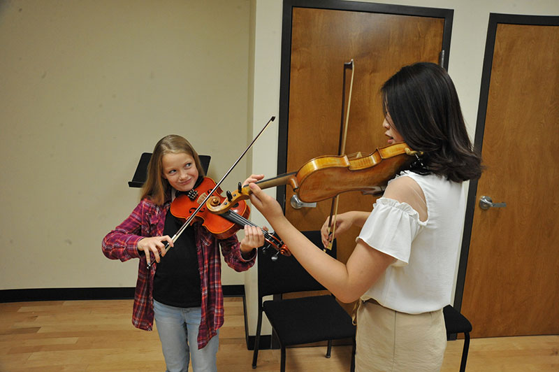Violin Student taking lesson as part of the Preparatory String Program