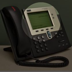 A desk phone with the Caller ID area highlighted.