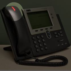 Desk Phone with the voicemail notification button highlighted.