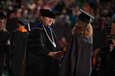 President  Vailas awarding a degree 2016 Commencement ceremony