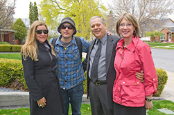 Laura Vailas with Honorary Doctor of Letters, Jakob Dylan, Paige Dylan, and the President Arthur Vailas